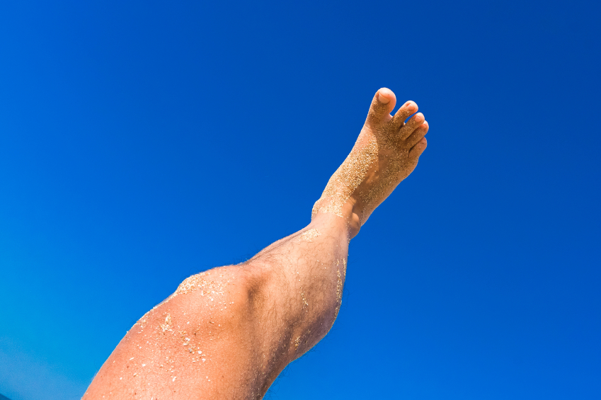 male leg on blue sky background