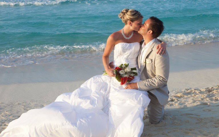 Couple Just Married Kissing On A Tropical Beach