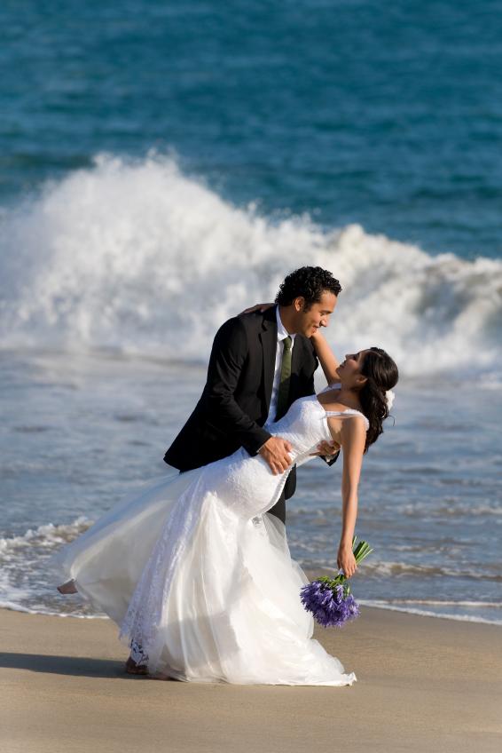 dancing at beach couple