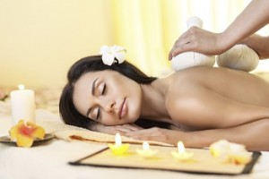 Young woman getting massage in Thai spa.