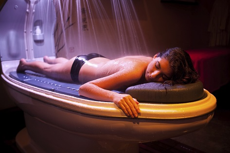 Laying relaxed woman during spa treatment.